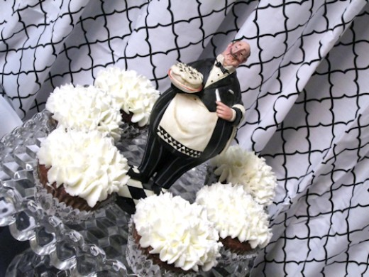 Close up of maitre'd and cupcakes