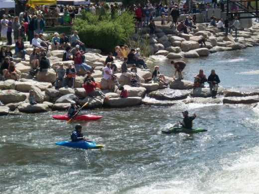 Observers and kayakers enjoying the Truckee River