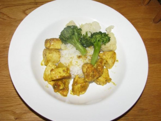 Curried Chicken with Brocolli and Cauliflower over Rice