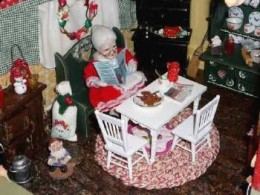 Mrs.  Santa Claus looks as if she is taking an afternoon coffee break in her Christmas homespun decorated kitchen...