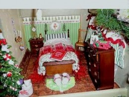 The Claus's bedroom is quaint, right down to Mrs. Claus's fluffy slippers at the end of the bed.