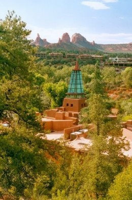 This building is located toward the end of Schnebly Hill Road, just as it enters Sedona. I think it is some kind of new age religious center