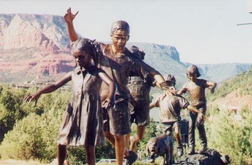 Someone who obviously lives in Sedona has placed many sculptures of children in various locations. These are very realistic (except they're made of metal, probably bronze).