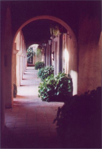 Covered walkway with arched entrances.