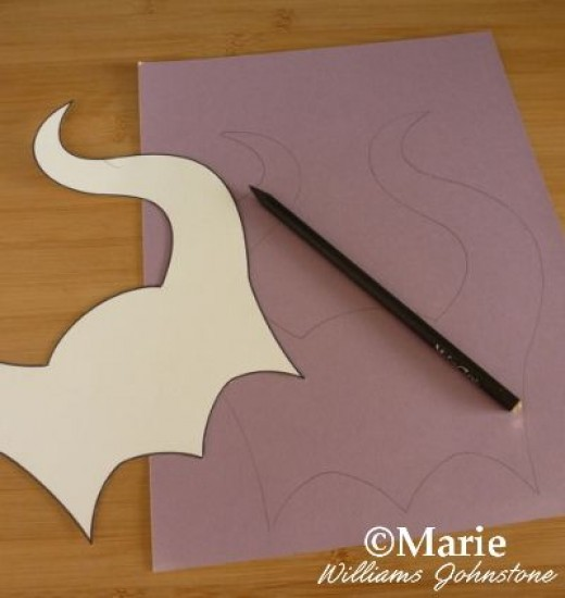 Trace around the template onto your choice of cardstock - if the card is flimsy, you can always stick two pieces together to make it stiffer and more suited to making a mask with. Alternatively you can use a thick craft foam or stick some felt onto c