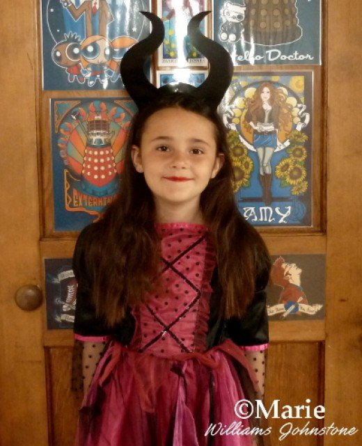 My little girl loves her DIY Maleficent evil witch headband for dressing up with and it's easy for her to pop off and on in her hair.