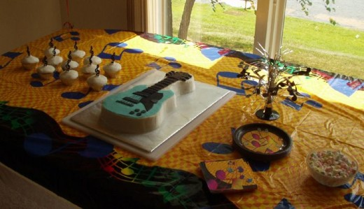 We used music note table decorations and paper goods, and a guitar cake.