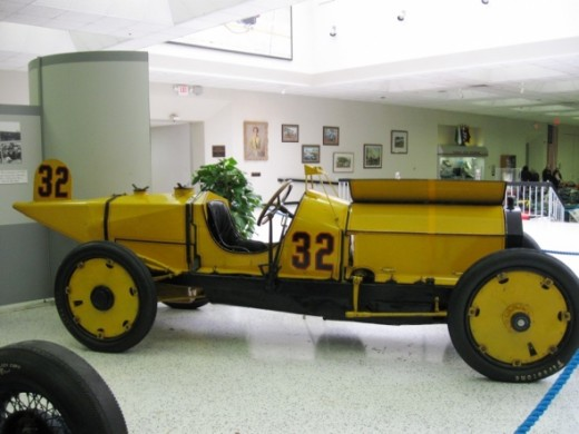 This is the winner of the first Indianapolis 500 Mile Race in 1911. It's a Marmon-Wasp driven by Ray Harroun. It featured the first known rearview mirror and saved weight by eliminating the riding mechanic. Marmon was a car manufacturer in Indianapol