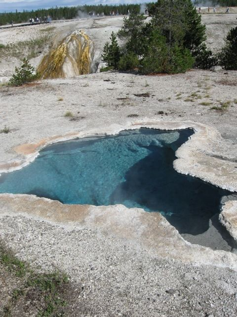 The Upper Geyeser Basin near old faithful. Turquoise blue, crystal clear pools.