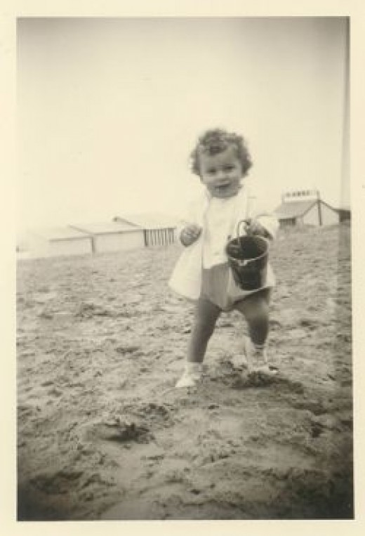 Unknown child on the beach at De Panne, Belgium (ca. 1959-1960) by jinterwas, on Flickr