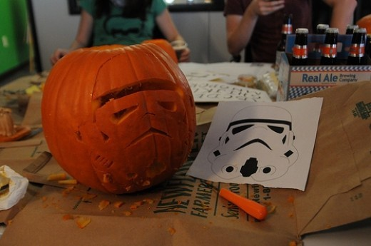 Star Wars Helmet Pumpkin Carving. There are so many Star War themes for pumpkins you could make. I've seen the death star which is perfect as it is round. Darth Vader with a light stick or glow in the dark stick.