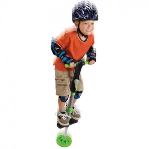 Boy Playing On A Pogo Stick