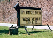 The Hike Inn sign: AT Service & Shuttle, Welcome Millennium Thru-Hikers