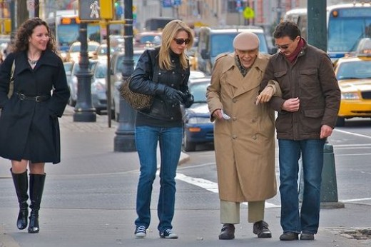 This older gentleman was having a difficult time walking, so this kind couple stopped and helped him to the bus stop and then onto the bus.