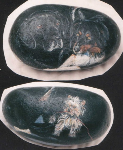 three dogs painted on a rock