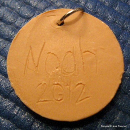 A great idea, to etch your child's name and date on the back of the pendant.