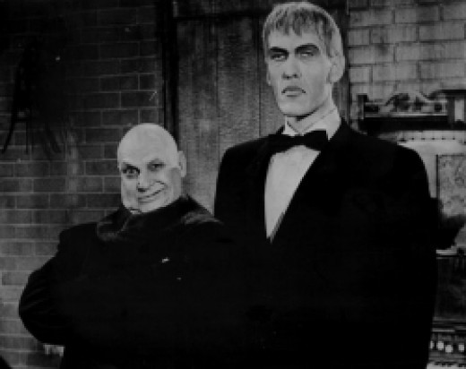 Uncle Fester & Lurch - By Pleasure Island Uploaded by We hope at en.wikipedia [Public domain], via Wikimedia Commons
