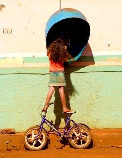 Young girl balancing precariously on a bicycle
