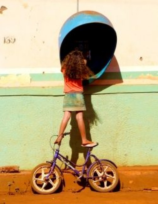 Young girl balancing precariously on a bicycle