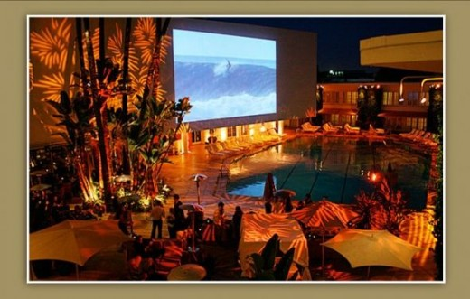 Olympic size Aqua Star pool at dusk...first run movies are shown on the huge outdoor screen