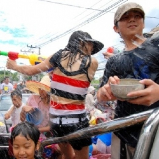 Shooting water guns at the Songkran Festival