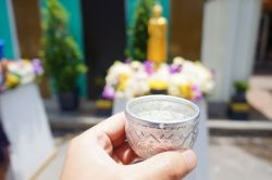 Scented water being offered at a Buddhist temple