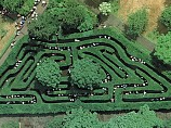 Hampton Court Palace, Herefordshire, UK hedge maze mostly consists of twisted paths.  The mazes now follow a single path and had no dead ends.