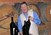 Hugh Johnson with oak barrels