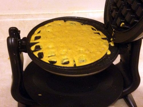 After pre-heating your waffle maker and spraying the irons with cooking spray, pour in the cornbread batter.