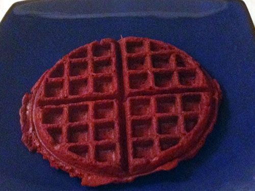 Carefully remove the cake batter waffle from the waffle iron.