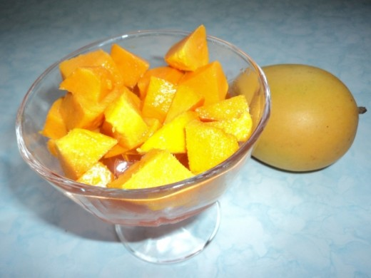 2nd Layer - Diced mangoes on top of Jello