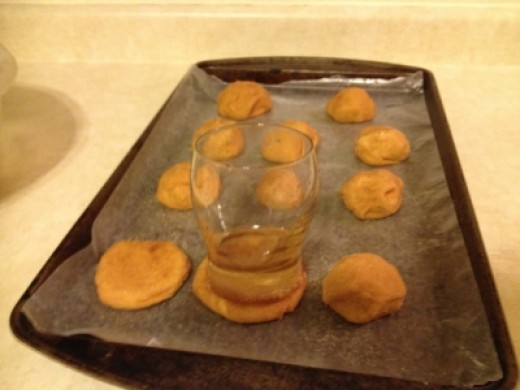 Step Fourteen:  Flatten Dough Balls with a Wet Glass Dipped in the Sugar Coating.