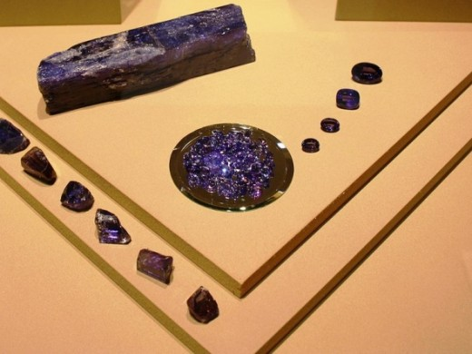All shapes and sizes of tanzanite: especially deep purple colored here. From the German Museum of Gemstones.