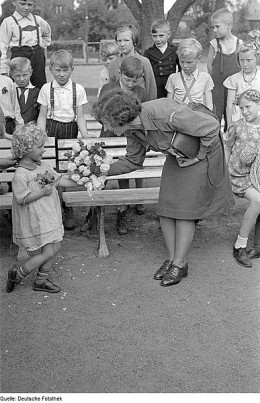 A German mother celebrates a gift from her little girl, time unknown. (All photos are public domain from Wikimedia Commons.)