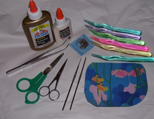 "The colorful plastics in upper right are contouring tools made from clear toothbrushes.  The mat is cut from a 'mouse' that is about 3/16"" thick - and firm."