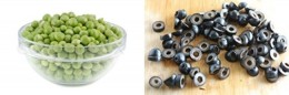 Get the bowl with the sweet peas and sliced olives out and add them to the salad bowl.