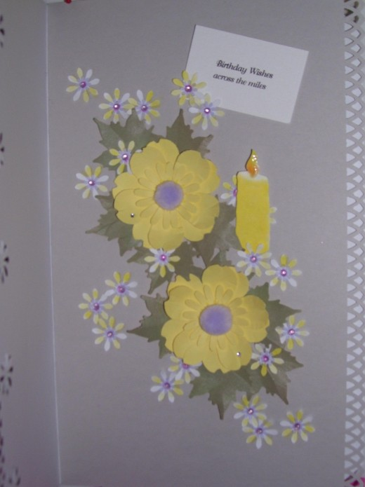This is the pom-pom flower centers. The card is really a pale lavender color.