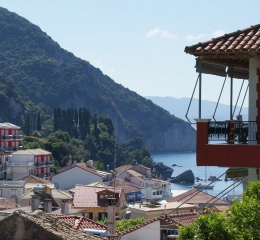 Parga rooftops with mountains in distance.