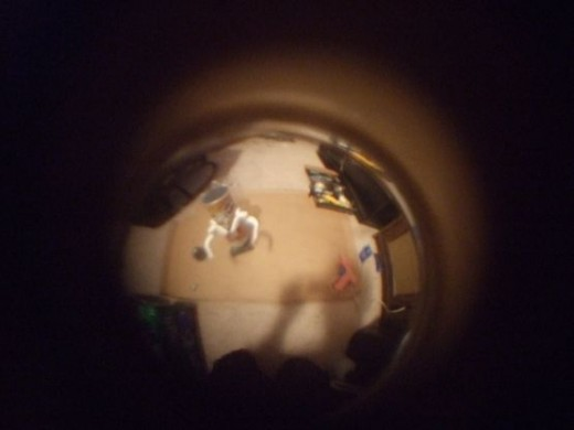 LookingThroughADoorholePeephole1