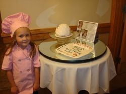 Abby with golf ball cake and handpainted ceramic platter.
