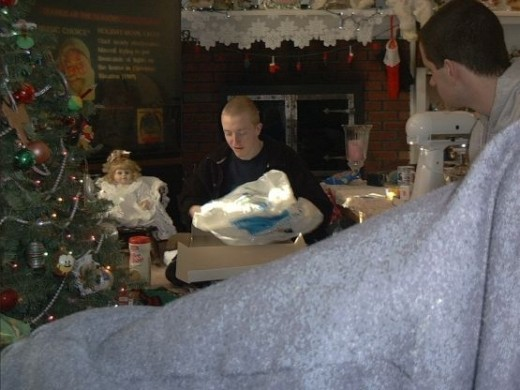 *This picture was taken on Christmas morning, December 25th, 2003. That's me opening a present, as my brother looks on.