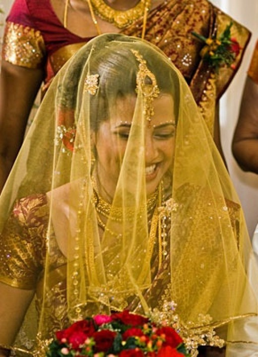 Dupatta covering the bride face