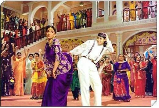 From the iconic Hum Aapke Hai Kaun. Madhuri Dixit looks stunning in a Purple coloured Saree