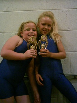 Jennifer and Amy proudly display their 5th place pairs trophies