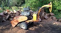 Stump Grinding Machine.This little baby is worth its weight in Gold !