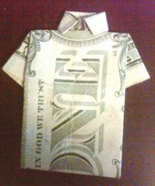 Shirt folded from one dollar bill (US $)