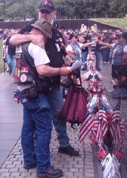 My husband comforting a Veteran at the Vietnam Wall 2011