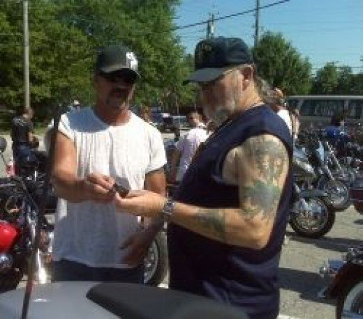 My husband exchanging emails at a bike event.