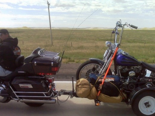 Bike pulling bike on highway
