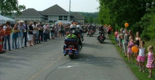 The group arrives in West Virginia, and the community is along the path to the Community Center to greet us.
